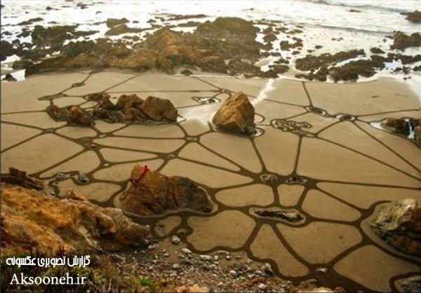 طراحی های هنرمندانه روی شن های ساحل