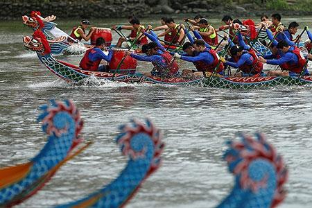 شرکت کنندگان در فستیوال قایق اژدها- تایپه، تاوان